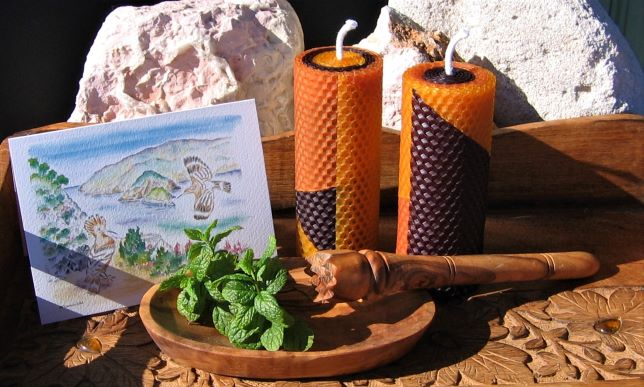 Two tribal beeswax candles, an olive wood mojito stick and a bowl and a greeting art card